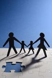Family figure on puzzle board stock photo