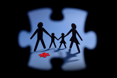 Family figure with red jigsaw piece. Cut out Family figure with red jigsaw piece Royalty Free Stock Images
