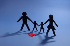 Family figure with red jigsaw piece. Cut out Family figure with red jigsaw piece Royalty Free Stock Photo