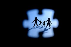 Family figure trough jigsaw puzzle Royalty Free Stock Photo
