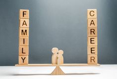 Family figures stand on scales between career and family. Conceptual balance in life, increasing attention to family and children. Limiting working hours per royalty free stock photo