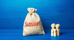 Family figurines and subsidies money bag. Financial support in paying bills. Providing tax breaks, low-interest soft loans