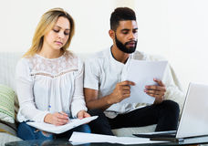 Family filling papers for mortgage Royalty Free Stock Photo