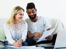 Family filling papers for mortgage Stock Photo