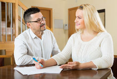 Family filling questionnaire for employee Stock Images