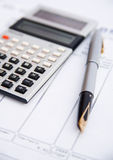 Family finances. A bank statement, solar powered calculator and pen  indicating that someone is carefully managing the family finances and alert for errors and Royalty Free Stock Photos
