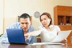 Family  with financial documents Royalty Free Stock Photo
