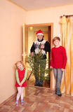 Family with fir  indoor Stock Photo