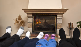 Family at a fireplace Stock Photography