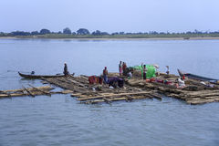 Irrawaddy River - Myanmar (Burma). Family of Fishermen living on a raft on the Irrawaddy River (Ayeyarwaddy River) in Myanmar (Burma).  It is the countrys Stock Photography