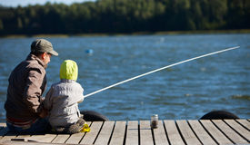 Family fishing. Father and small son fishing together on lake Royalty Free Stock Photography