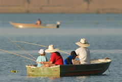 Family fishing. A family fishing in a boat stock photography