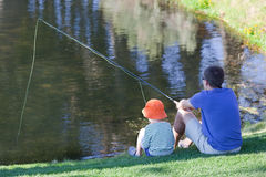 Family fishing. Father and his son fishing together stock photography