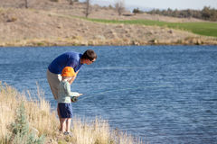 Family fishing. Family of father and son fishing together stock images