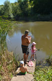 Family fishing. Grandfather and grandchildren, fishing tackles, outdoors, summer, Sunny Stock Images
