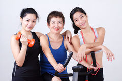 Family in Fitness. Grandmother working out with young ladies Royalty Free Stock Photo