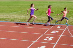 Family fitness, active mother and kids running on stadium track Royalty Free Stock Photos