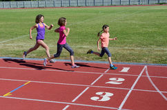 Family fitness, mother and kids running on stadium track, training and children sport healthy lifestyle Stock Photography