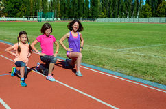 Family fitness, mother and kids training on stadium, sport with children Stock Photo