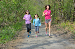 Family fitness and sport, active mother and kids jogging outdoors, running in forest Stock Photography