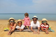 Family of five on the beach. Travel and family vacation concept royalty free stock photos