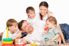 Family of a five on carpet. Cute family of a five on carpet royalty free stock photo