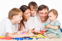 Family of a five on carpet Royalty Free Stock Images