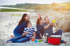 Family of five doing selfy at the picnic on the beach Royalty Free Stock Photos
