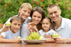 Family of five eating fruits Royalty Free Stock Photo