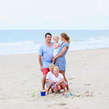 Family of five having fun on the beach Stock Image