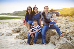 Family of five having fun on the beach Royalty Free Stock Image