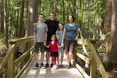 Family of five hiking. In the woods royalty free stock photos
