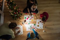 Family of five making holiday decorations royalty free stock photos