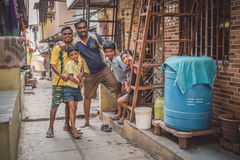 Family of five. MUMBAI, INDIA - 16 JANUARY 2015: Five family members stand together in slum street. Post-processed with grain, texture and colour effect Stock Image