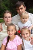 Family of five outdoor in summer. Family of five with seriuos parents outdoor in summer stock photography
