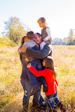 Family of Five Outdoors. Nuclear family of five people including a mother father and three children stand together outdoors for this family picture stock photos