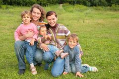 Family of five portrait on grass. Family of five portrait on green grass royalty free stock photos