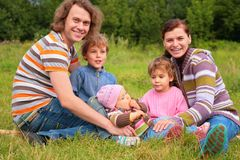 Family of five portrait on grass. Family of five portrait on green grass royalty free stock photography