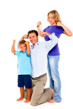 Family  flexing muscles. In white background Royalty Free Stock Image