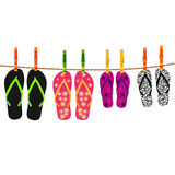 Family flip flops with rope and clothespins Royalty Free Stock Photography