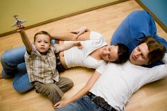 Family on a floor Royalty Free Stock Images