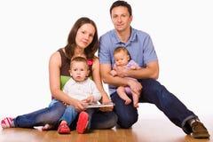 Family on floor Royalty Free Stock Photos