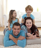 Family on floor in living-room Stock Photo
