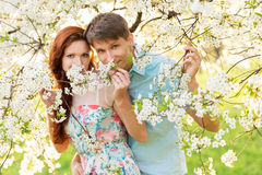 Family in flower garden Royalty Free Stock Images