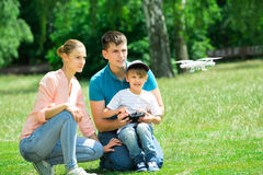 Family Flying Drone In The Park stock photography