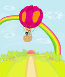 Family flying a hot air balloon over the rainbow Royalty Free Stock Photos