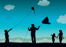 Family flying kite Stock Images