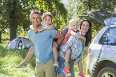 Family Flying Kite Camping Holiday In Countryside Royalty Free Stock Images