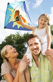 Family Flying Kite In Countryside. Smiling Royalty Free Stock Photography