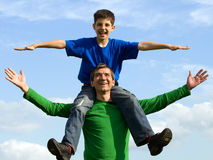 Family flying in the skies Royalty Free Stock Photo